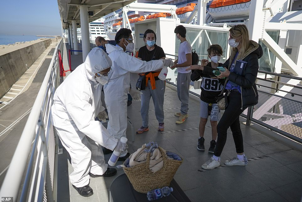 Passengers and crew are tested before and during cruises. Mask mandates, temperature checks, contact-tracing wristbands and frequent cleaning of the ship are all designed to prevent outbreaks