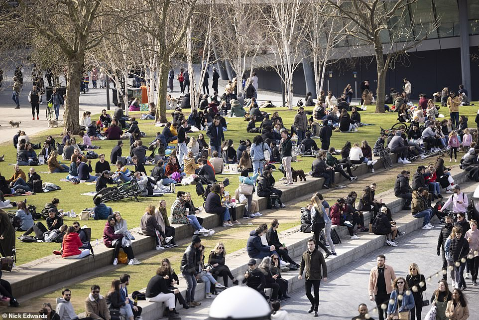 Crowds flock to Potters Fields next to Tower Bridge in London to enjoy the sunshine at the start of the four-day Easter weekend