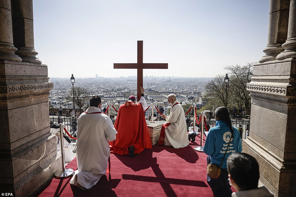 FRANCE: Archbishop Monseigneur Aupetit (C-L) performs during the Stations of the Cross ceremony as part the Good Friday procession at the Sacre-Coeur (sacred heart) basilica atop Montmartre overlooking Paris