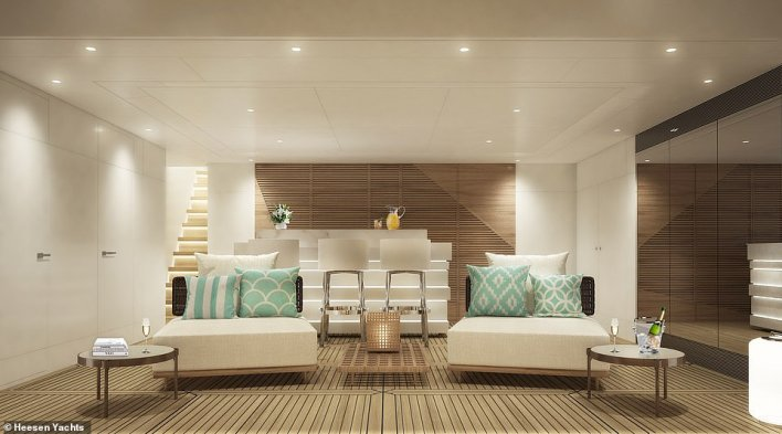 Billowing clouds of white and taupe lend an ethereal elegance to Aura's interior, says Heesen. Pictured is the beach club