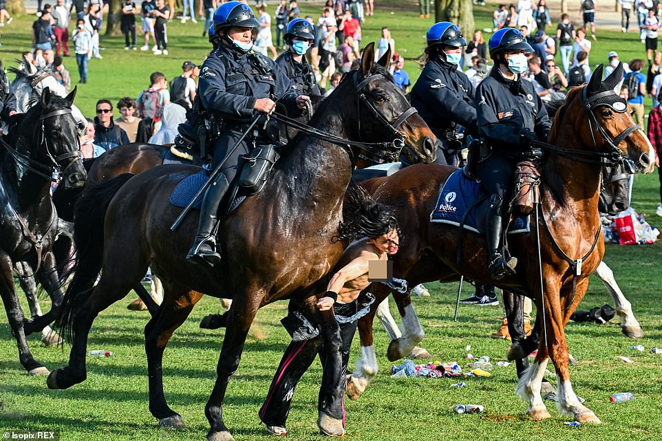 It remains unclear if the girl was knocked out on impact with the police horse, but she appears to remain motionless after the collision
