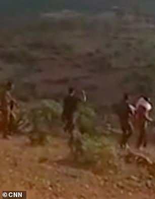 The soldiers lead the unarmed men before shooting them in the head