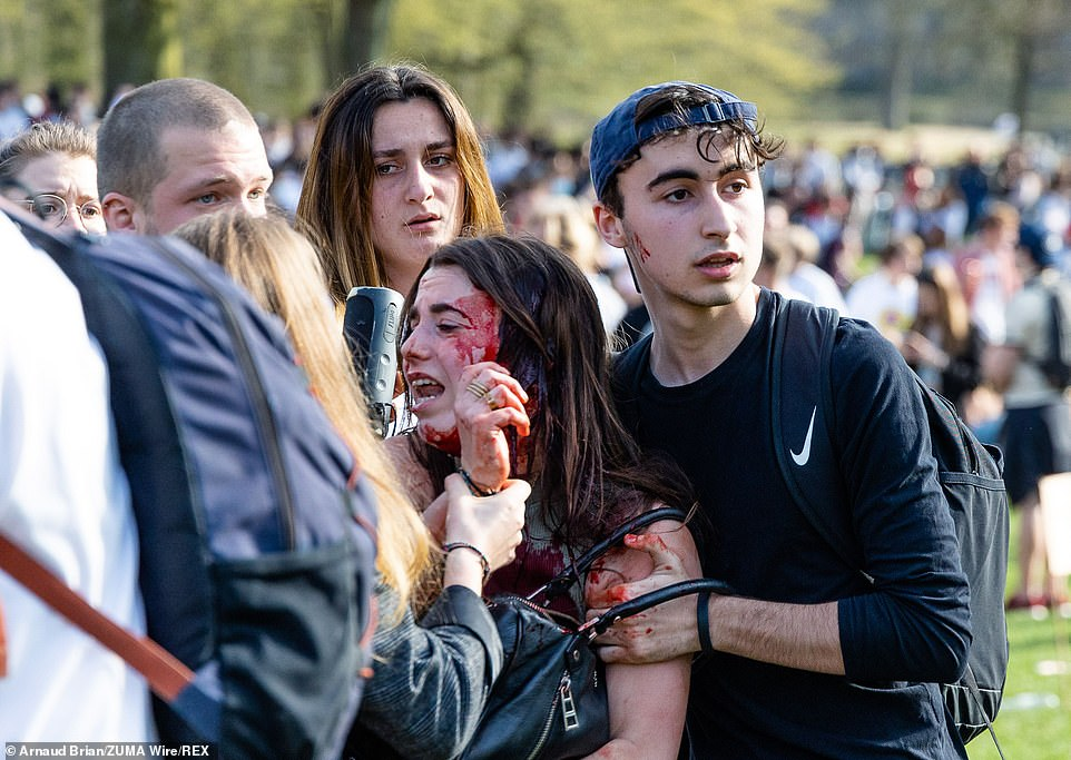 A woman was seen covered in blood at the park during the protest in Brussels