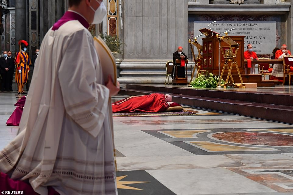 Pope Francis lies down in prayer prior to celebrate Good Friday Mass for the Passion of the Lord today