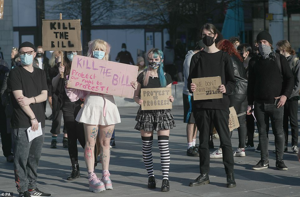 Demonstrators hold up placards during a 'Kill the Bill' protest against the Police, Crime, Sentencing and Courts Bill in Guildhall Square, Southampton, today