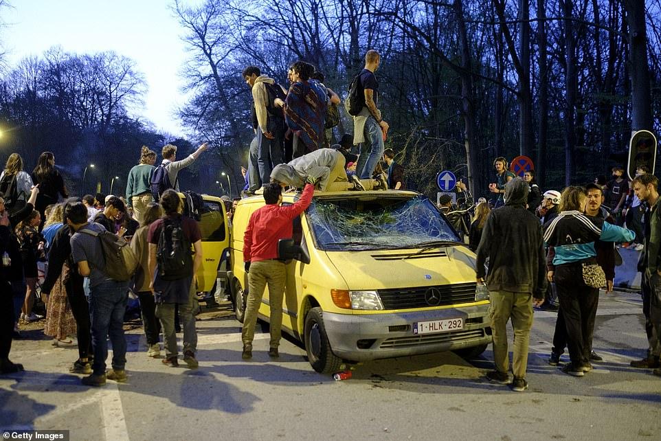 Party goers were seen standing on a van inBelgium. The windscreen was smashed
