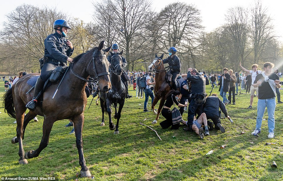 Mounted police officers surround protesters at the park in Brussels