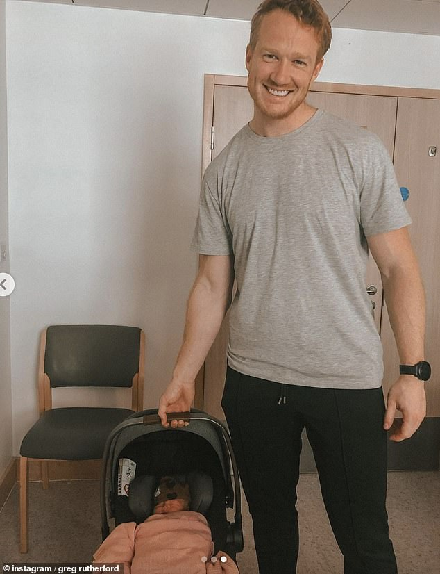 Proud: Greg was also seen carrying Daphne's carseat while beaming a smile as they headed home from the hospital