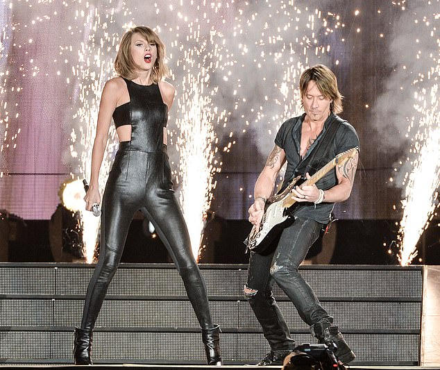 Teaming up? The letters 'TEKHI' and 'RUNBA' rearranged spell out the name of Keith Urban, suggesting he will appear of one of the ones' seen in 2015