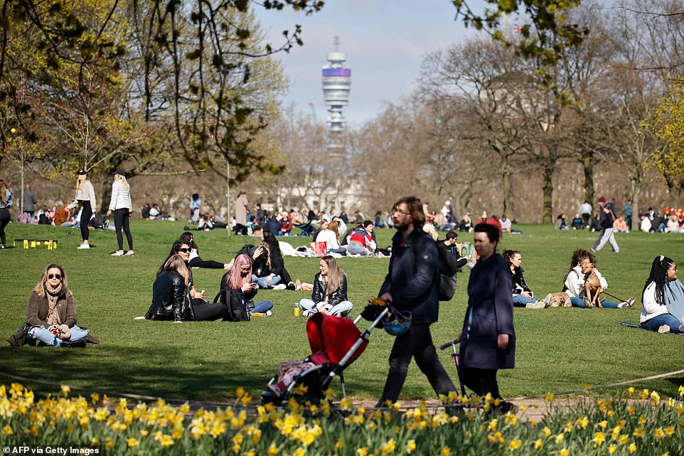 Crowds gathered with friends in the sunshine in London's Hyde Park this afternoon to kick off the four-day weekend