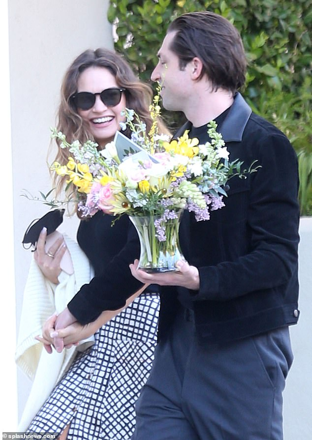 Smitten:Lily James and her American rocker boyfriend Michael Shuman looked more loved-up than ever during a romantic stroll in Los Angeles, California, last week