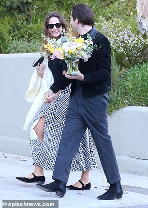 Details:The giggling actress finished her look with a knitted cardigan, black suede heels and chic sunglasses