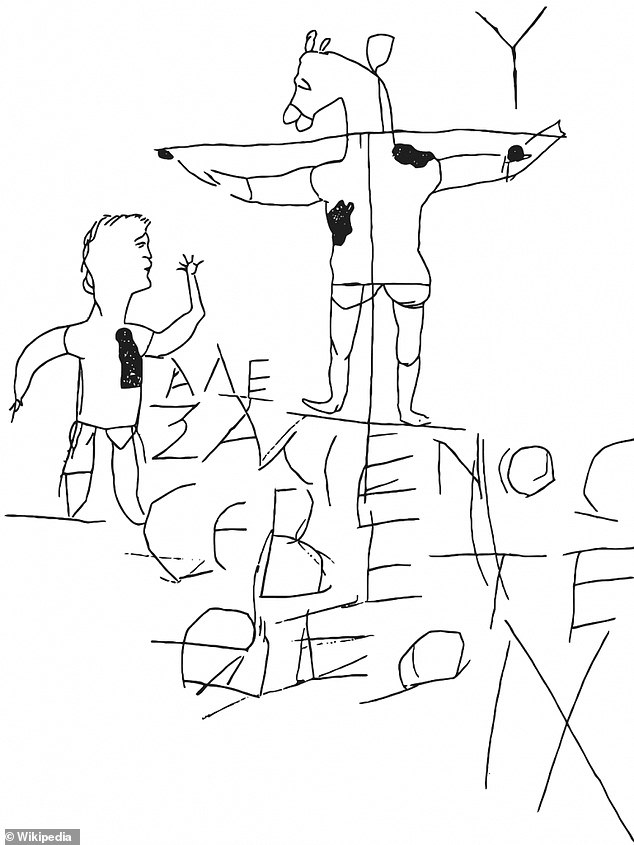 Beneath the cross is ancient Greek text that reads, 'Alexamenos worships God,' as a way to mock an individual in the drawing who appears to be dressed like a slave