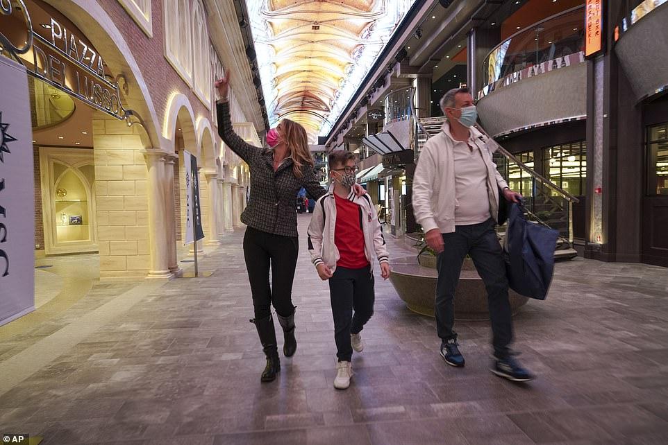 Passengers (left to right) Ilaria Gelli, Matteo Marzocchi, and Federico Marzoochi board the Grandiosa in Civitavecchia, near Rome, ready for their cruise