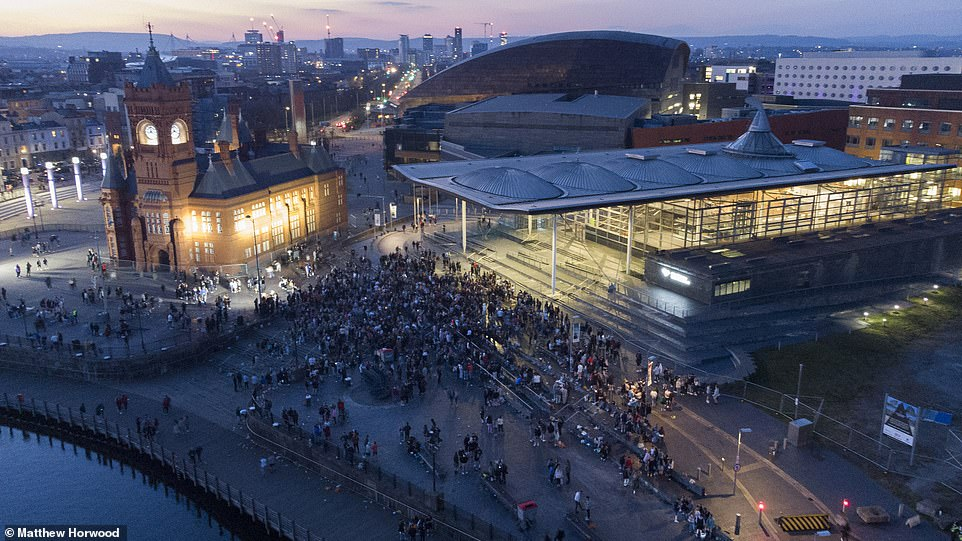 An aerial view as crowds gather during the warm weather on the steps of the Senedd, home of the Welsh Parliament