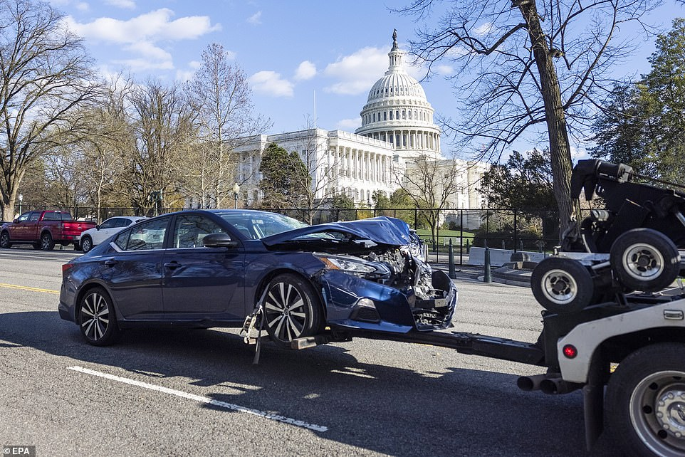 The vehicle is towed from the scene of the attack that left a Capitol police officer and the suspect dead