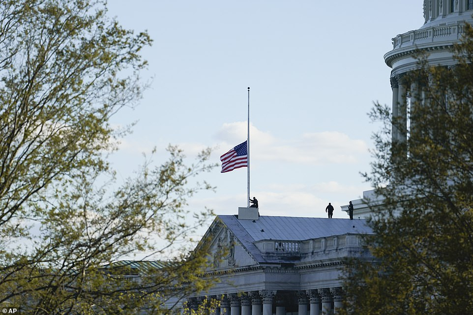 The American flag at the US Capitol is lowered to half-staff in honor of Capitol Police officer William Evans