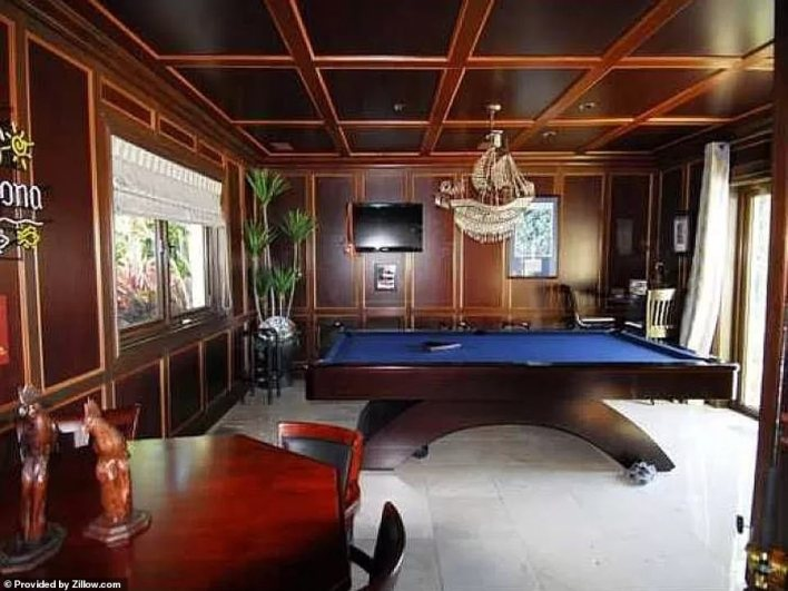 This wood paneled room make this the perfect spot for a game of pool