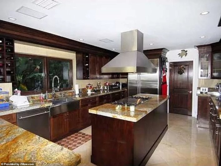 An island kitchen allows for plenty of preparation space at meal times