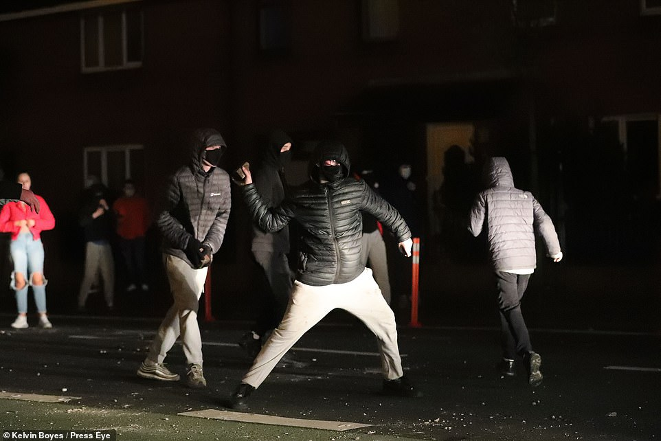 Loyalists take part in a protest at Shaftsbury Square near Sandy Row in south Belfast as the PSNI moved in to disperse the crowd