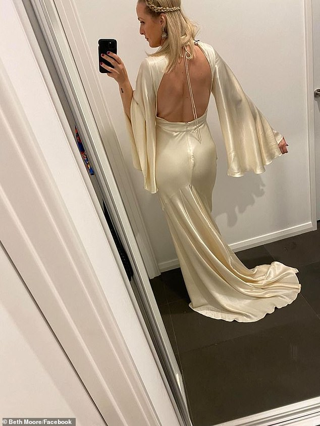 Dress me up: She modeled the dress in a series of photos and showed the open back to fans