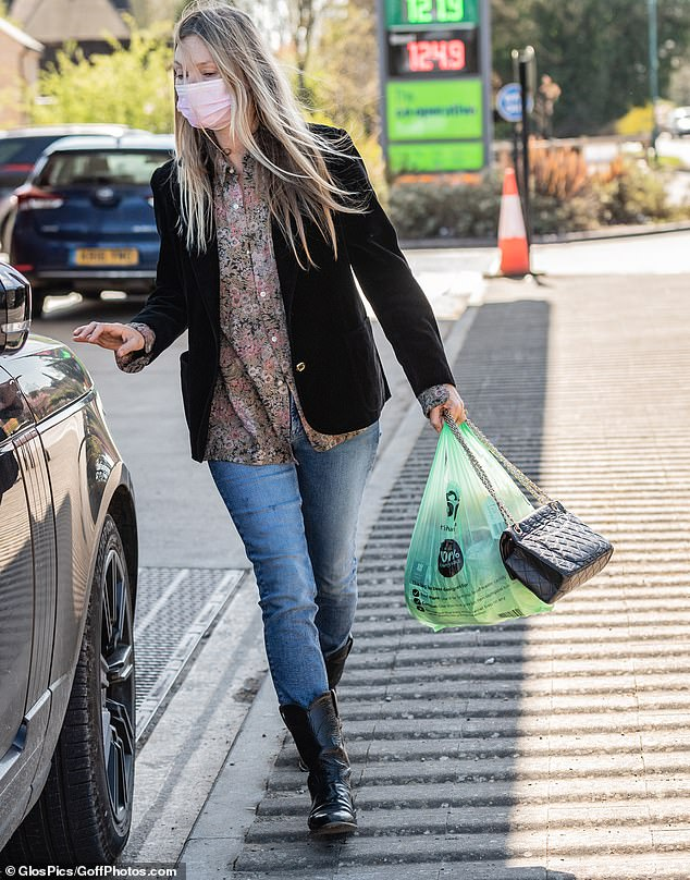 Relaxed look: Kate Moss looked typically chic on Saturday in a velvet blazer and floral shirt in a muted colour palette, as she was spotted purchasing groceries at her local store