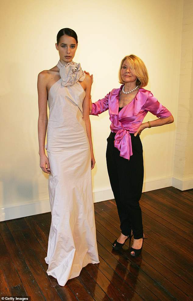 Strike a pose! Carla and one of her models pose together during a fashion show in 2008