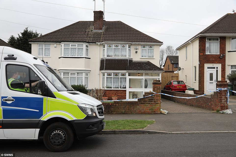 A police cordon remains in place outside the property in Rowley Regis, near Birmingham, where tragedy struck on Friday