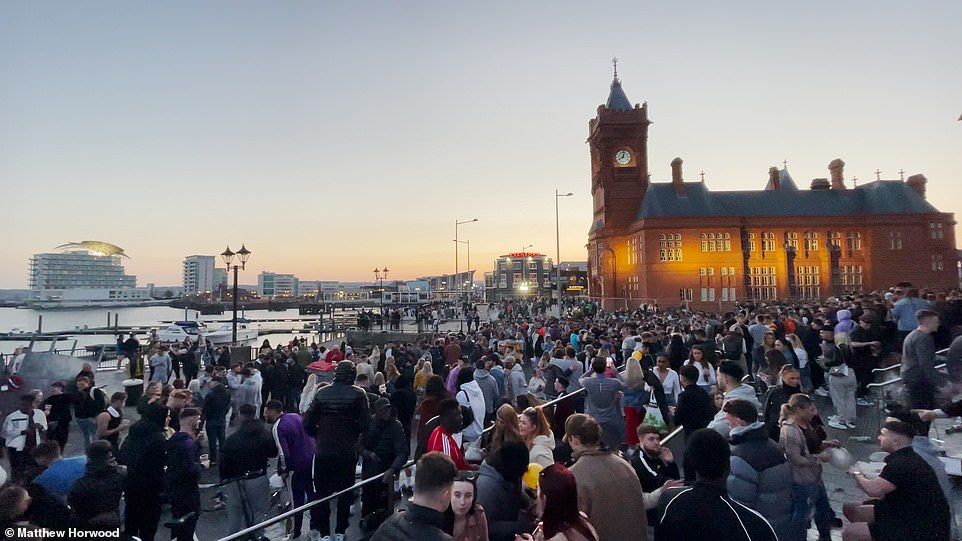 The Welsh capital was brimming with people who gathered at Cardiff Bay into the evening but hopes of partying the rest of the weekend may be dashed as the weather turns colder