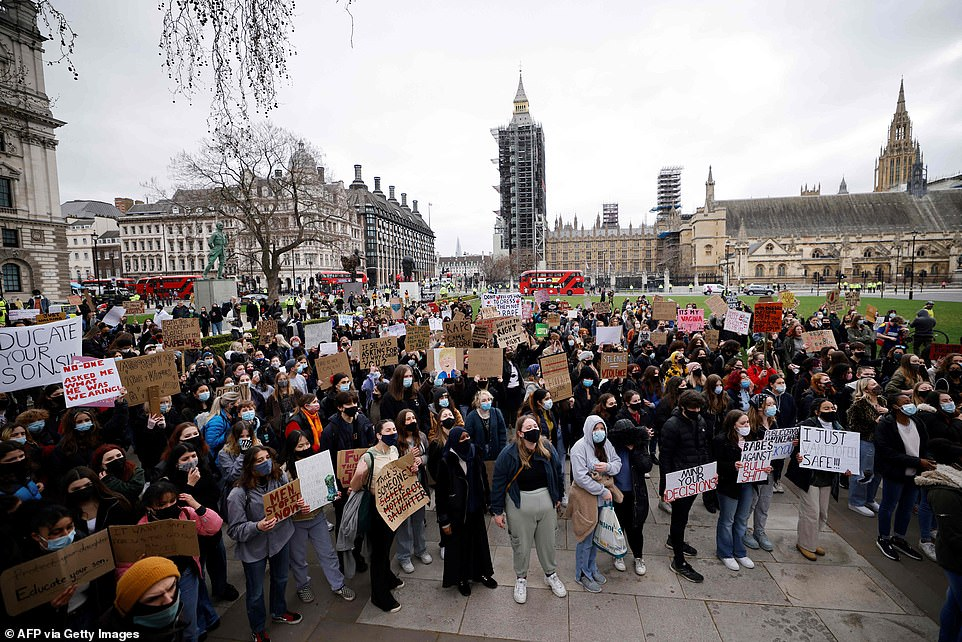 Thousands of Kill the Bill activists have descended on London as police brace for weekend of chaos with more rallies set to take place in towns and cities across the UK. Pictured: Protestors in Parliament Square