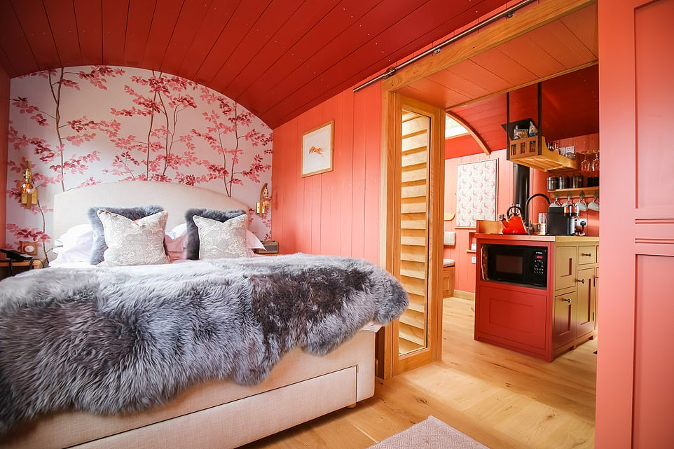 Inside one of the five luxury lodges at Lympstone Manor in Devon. Each one hashand-painted wallpaper, double glazing and glass panels in the roof for star-gazing