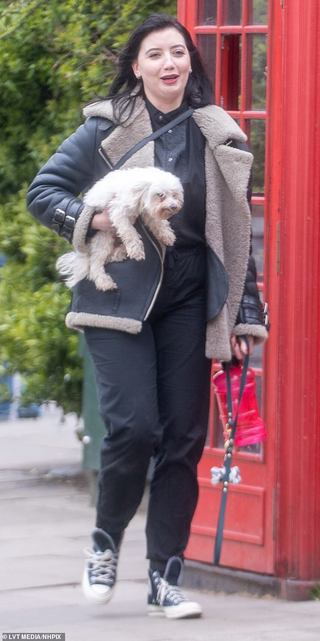 Pretty: Daisy Lowe, 32, proved she could rock laid-back styles too as she stepped out in a black leather sheepskin jacket while she carried her dog Monty on a low-key stroll