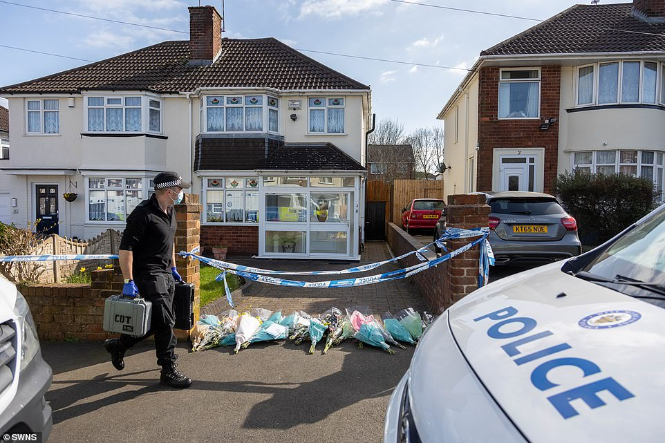 As police continued to investigate at the victim's property, neighbours left floral tributes in memory of the pensioner