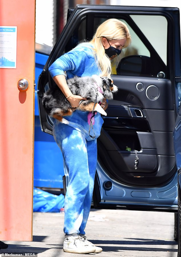 Cool clothing: The former Playboy Bunny wore a blue and white tie-dye hoodie and matching sweatpants as she stepped out