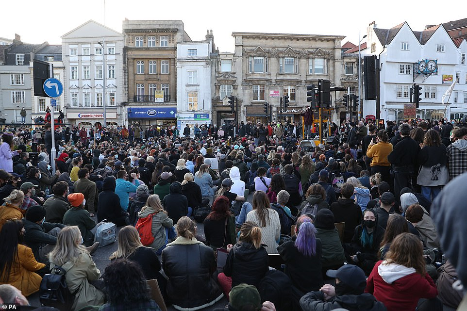 Demonstrators sit on Baldwin Street in Bristol during a 'Kill the Bill' protest on Saturday against the Government-proposed bill