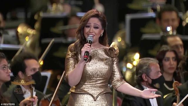 Riham Abdel Hakim performs at the ceremony. Once at the new museum, 20 of the mummies will be displayed, while the remaining two will be stored, according to the ministry
