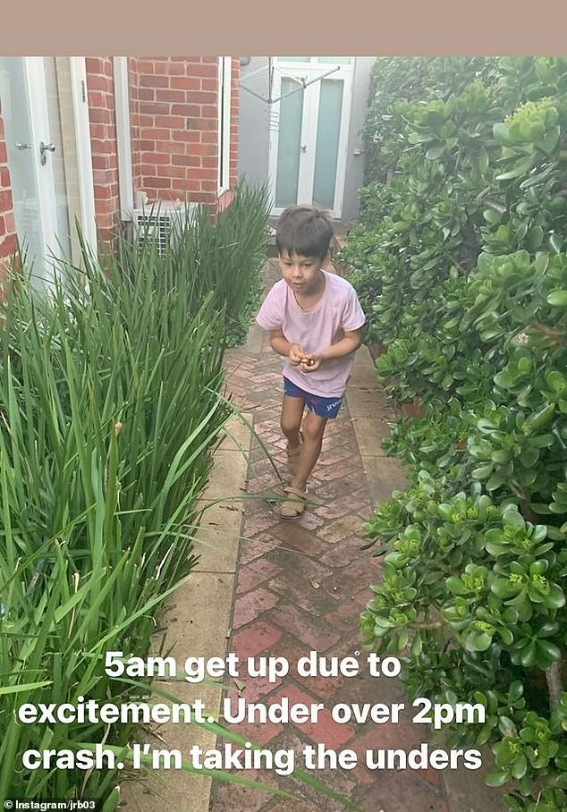 How many can you find? Jimmy Bartel's two children, Aston, five, (pictured) and Henley, two, were seen rummaging round the garden trying to dig-up Easter eggs