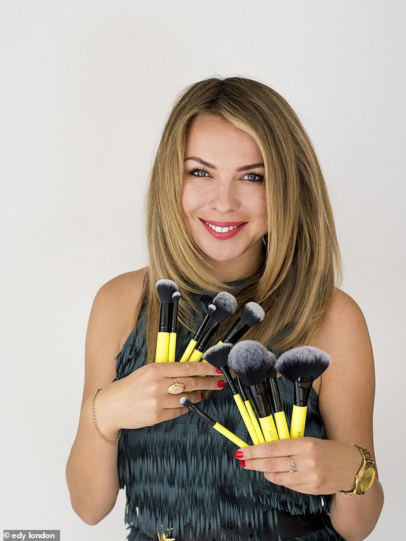 Make up artist Edy London is pictured holding her brushes. She told FEMAIL dewy skin, natural eyelash extensions and bold lips are set to be trends for the summer