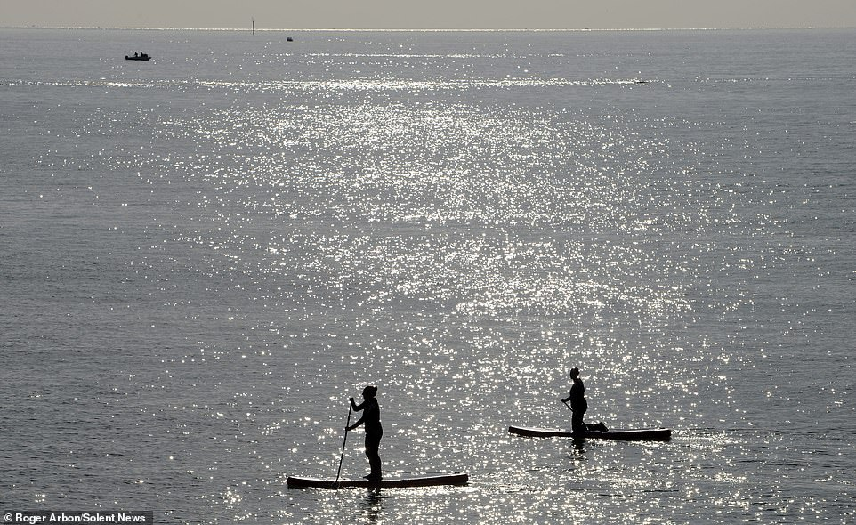 Paddle boarders make the most of the early sunshine in Southsea, Hampshire, on Easter Sunday, before temperatures are set to plummet on Monday