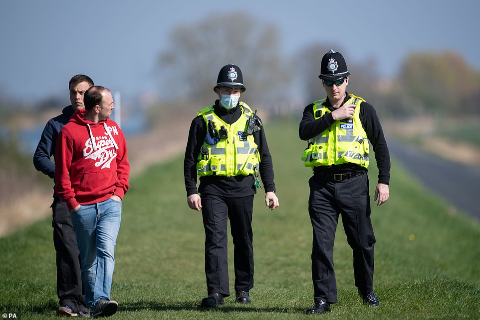 Crowds gathered to watch the Boat Race on the River Great Ouse near Ely in Cambridgeshire, but were moved on by police