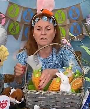 Fergie donned bunny ears and a flower crown on her head for the video showing her carrot bags full of cheesy Wotsits