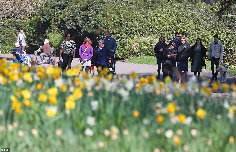 Families gather together in Sefton Park in Liverpool on Easter Sunday, as the rule of six permits two households to meet outdoors