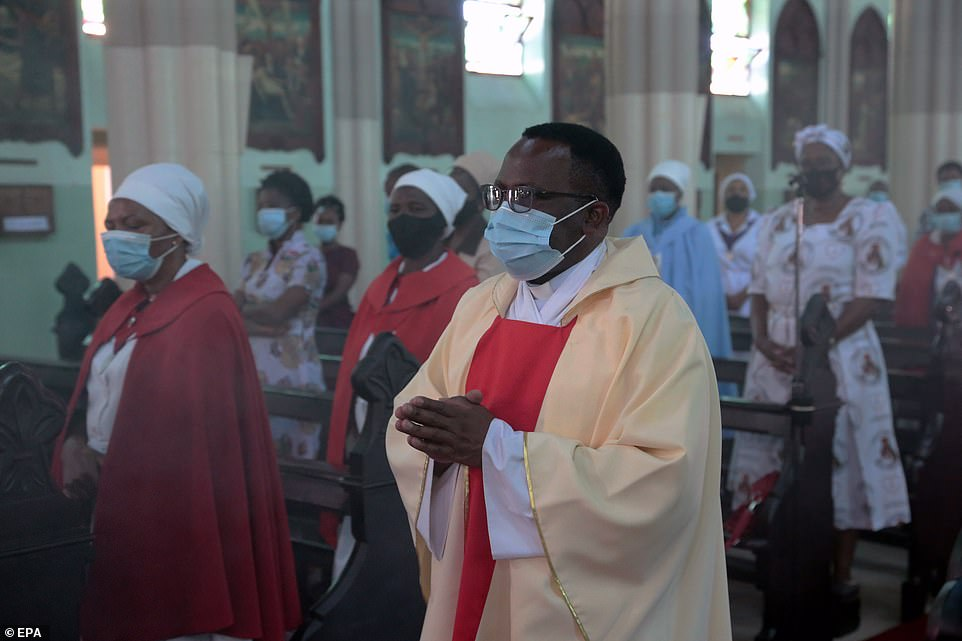 A priest leads an Easter Sunday mass at the Roman Cathedral in Harare, Zimbabwe
