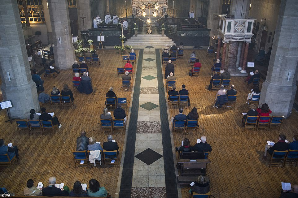 Members of the congregation socially distance during the Easter Sunday service at the Holy Trinity Sloane Square church in Chelsea, London