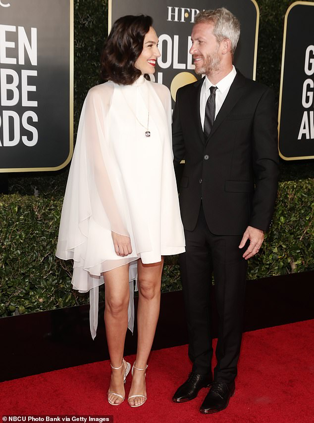 First indication: Many began to speculate that the Wonder Woman actress was pregnant for a third time after her appearance at the 78th Golden Globe Awards in February; she is seen with her husband before the start of the ceremony