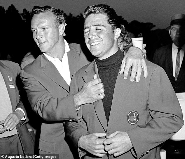 Gary Player (right) received his first green jacket from golf legend Arnold Palmer (left) in 1961