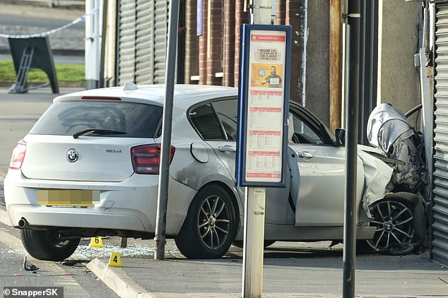 The driver fled the crash site in Brownhills, Walsall, after the incident at around 4pm on Easter Sunday but a man was arrested around four miles away in Bloxwich shortly afterwards. Pictured is a close up of the BMW
