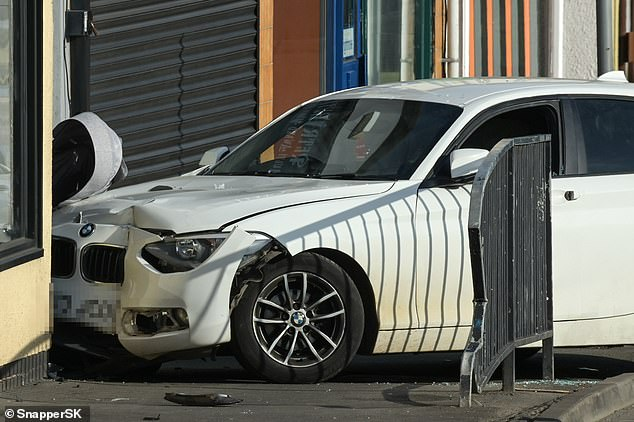 Police believe BMW1 Series crashed into a Ford B-Max (pictured) before ploughing onto the pavement and pinning the mother and baby against a wall