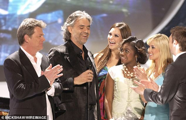 Taylor Hicks won that year:It was a full circle moment for the Country Comfort actress (3-L), who met Bocelli (2-L) when he served as guest mentor alongside her future husband David Foster (L) on the formerly Fox singing competition in 2006