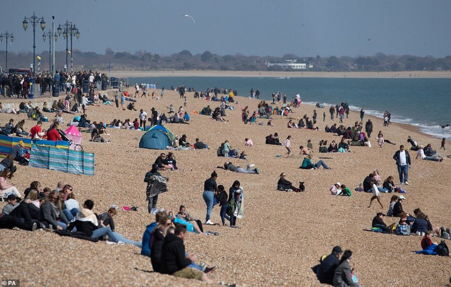 People enjoy the warm weather on Southsea beach in Hampshire on Easter Sunday following a warm bank holiday weekend